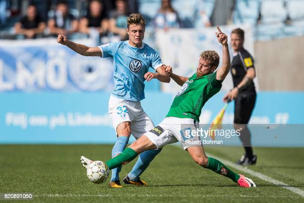 Mattias Svanberg of Malmo FF and Stefan Karlsson of Jonkopings Sodra during the Allsvenskan match between Malmo FF and Jonkopings Sodra IF at...