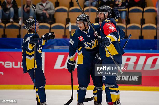 Mattias Tedenby of HV71 Teemu Laine of HV71and Ryan O´Byrne of HV71 celebrate a goal during the Champions Hockey League group stage game between HV71...