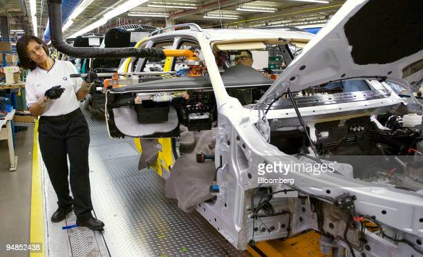 Mattie Connor guides a dashboard into a BMW X5 during assembly inside the Bayerische Motoren Werke factory in Greer South Carolina US on Thursday...