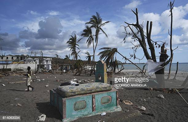 TOPSHOT A mattress is dried in the sun on a grave at a beach destroyed by Hurricane Matthew in Port Salut southwest of PortauPrince on October 11...