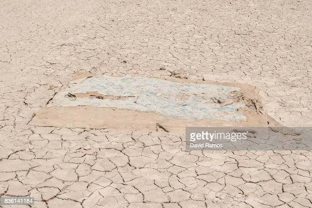 A mattress lies on dried cracked mud at Entrepenas reservoir second largest water reservoir feeding the Segura River and Spain's Southeastern regions...