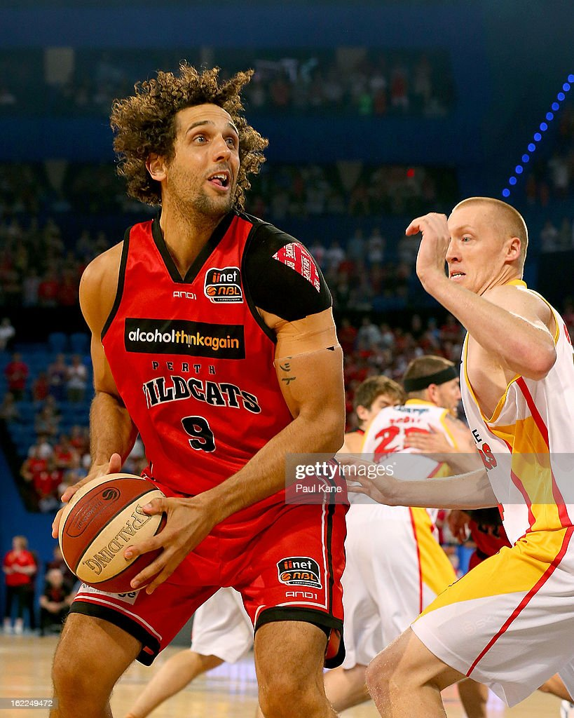 Mattthew Knight of the Wildcats looks to pass against Adam Ballinger of the Tigers during the round 20 NBL match between the Perth Wildcats and the Melbourne Tigers at Perth Arena on February 21, 2013 in Perth, Australia.