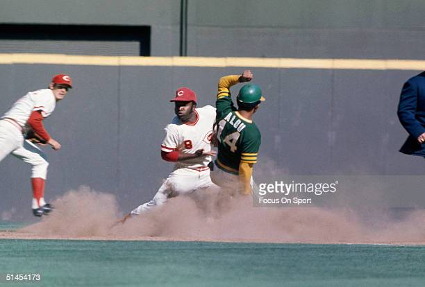 Matty Alou 14 of the Oakland Athletics slides into second base as Cincinnati Reds' Joe Morgan takes the throw during the World series at Riverfront...