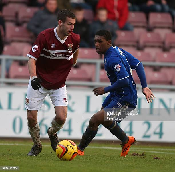 Matty Blair of Northampton Town looks to move past Tendayi Darikwa of Chesterfield during the Sky Bet League Two match between Northampton Town and...