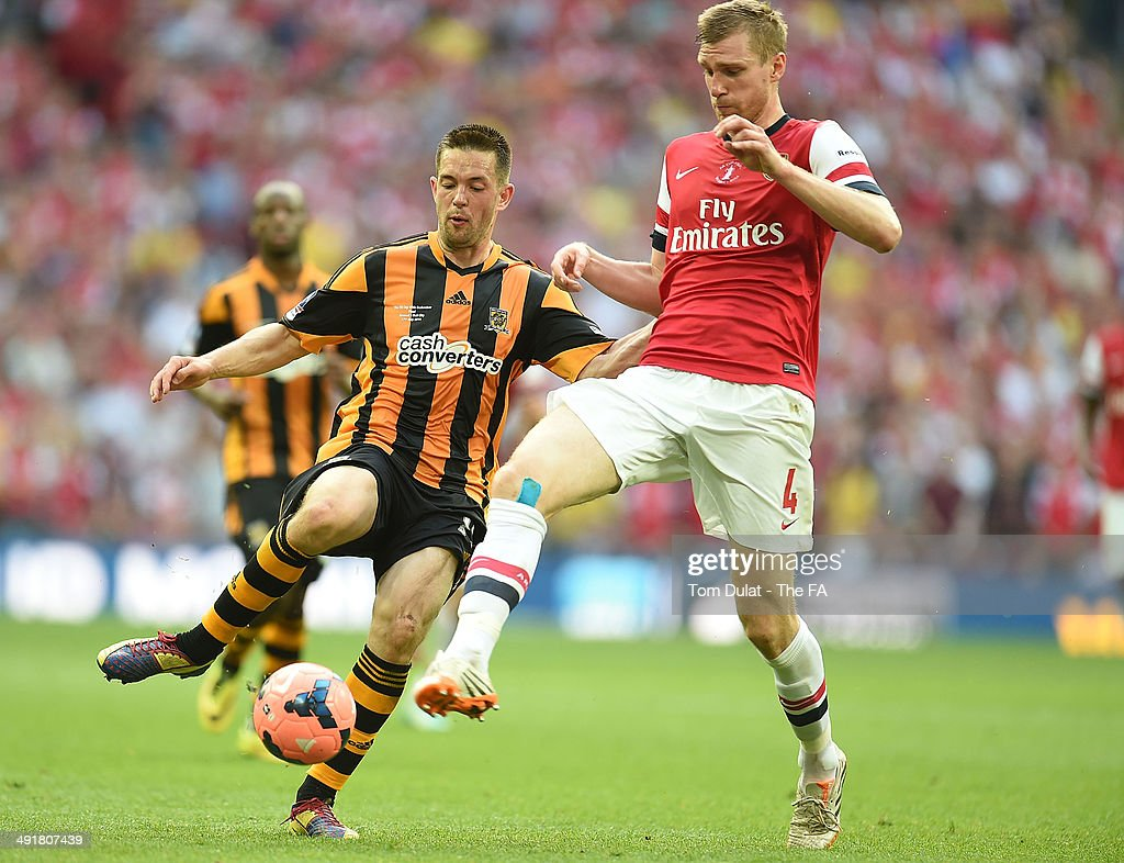 Matty Fryatt of Hull City and Per Mertesacker of Arsenal battle for the ball during the FA Cup with Budweiser Final match between Arsenal and Hull City at Wembley Stadium on May 17, 2014 in London, England.