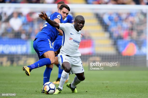 Matty James of Leicester City and N'Golo Kante of Chelsea battle for possession during the Premier League match between Leicester City and Chelsea at...