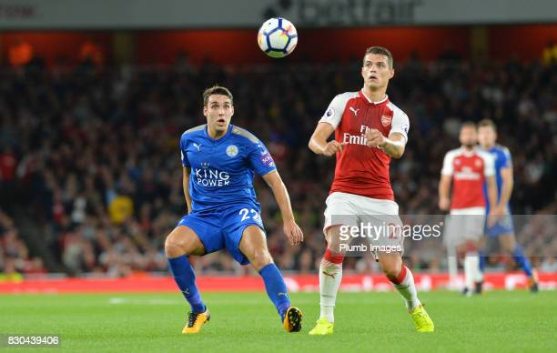 Matty James of Leicester City in action with Granit Xhaka of Arsenal during the Premier League match between Arsenal and Leicester City at Emirates...