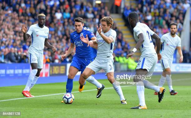 Matty James of Leicester City in action with Marcos Alonso of Chelsea during the Premier League match between Leicester City and Chelsea at King...