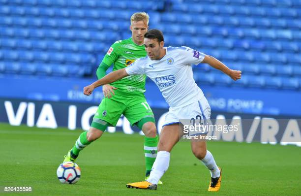Matty James of Leicester City in action with Oscar Wendt of Borussia Monchengladbach during the Leicester City v Borussia Monchengladbach Preseason...