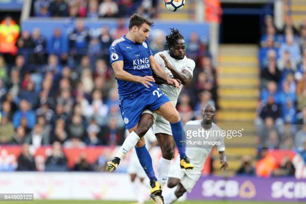 Matty James of Leicester City in action with Victor Moses of Chelsea during the Premier League match between Leicester City and Chelsea at King Power...