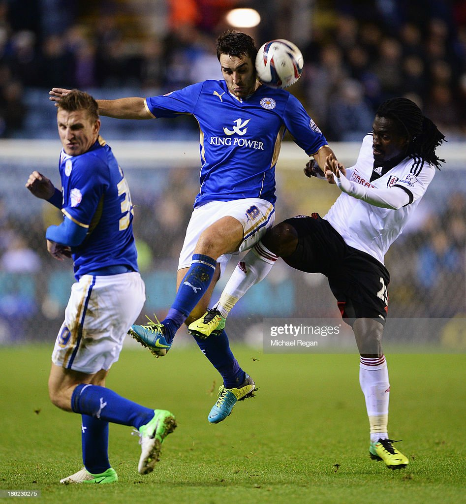 Matty James of Leicester City is challenged by <a gi-track='captionPersonalityLinkClicked' href=/galleries/search?phrase=Derek+Boateng&family=editorial&specificpeople=535783 ng-click='$event.stopPropagation()'>Derek Boateng</a> of Fulham during the Capital One Cup fourth round match between Leicester City and Fulham at the King Power Stadium on October 29, 2013 in Leicester, England.