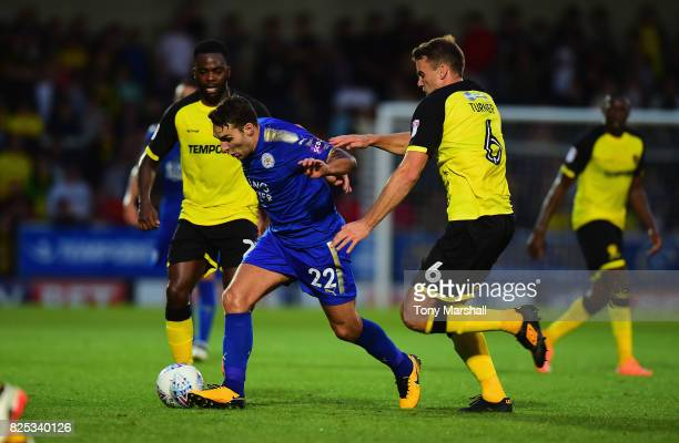 Matty James of Leicester City is tackled by Ben Turner of Burton Albion during the PreSeason Friendly match between Burton Albion v Leicester City at...