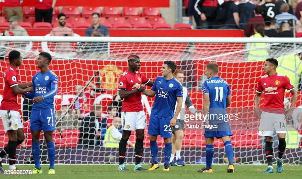 Matty James of Leicester City shakes hands with Paul Pogba of Manchester United after the Premier League match between Manchester United and...