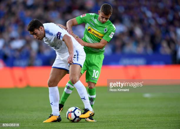 Matty James of Leicester is challenged by Thorgan Hazard of Borussia Moenchengladbach during the preseason friendly match between Leicester City and...