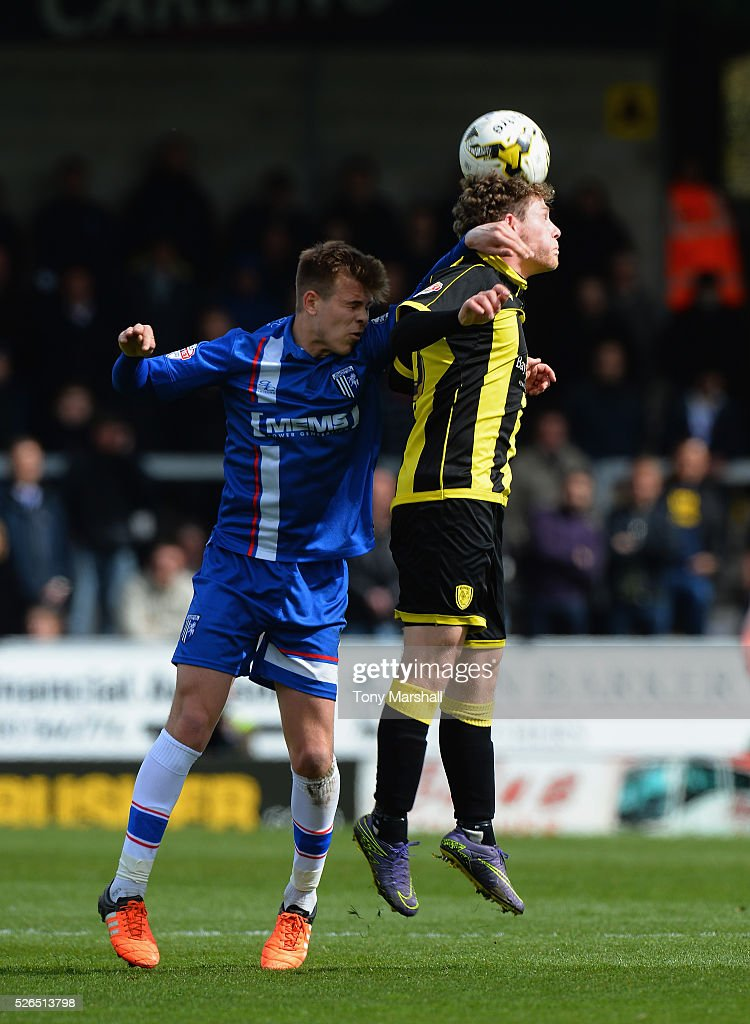 Matty Palmer of Burton Albion is tackled by Jake Hessenthaler of Gillingham during the Sky Bet League One match between Burton Albion and Gillingham at Pirelli Stadium on April 30, 2016 in Burton-upon-Trent, England.