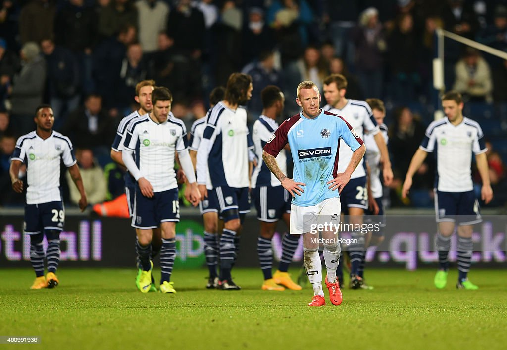 Matty Pattison of Gateshead looks dejected as Chris Brunt of West Bromwich Albion scores their fifth goal during the FA Cup Third Round match between...