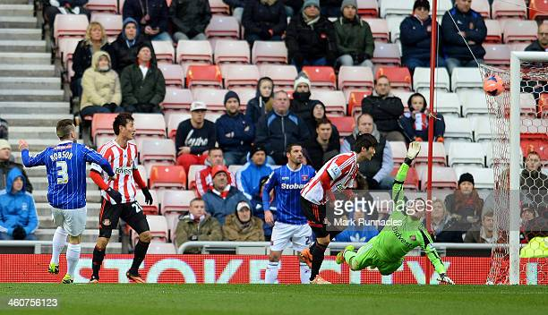Matty Robson of Carlisle scores a goal to level the scores at 11 during the Budweiser FA Cup third round match between Sunderland and Carlisle United...