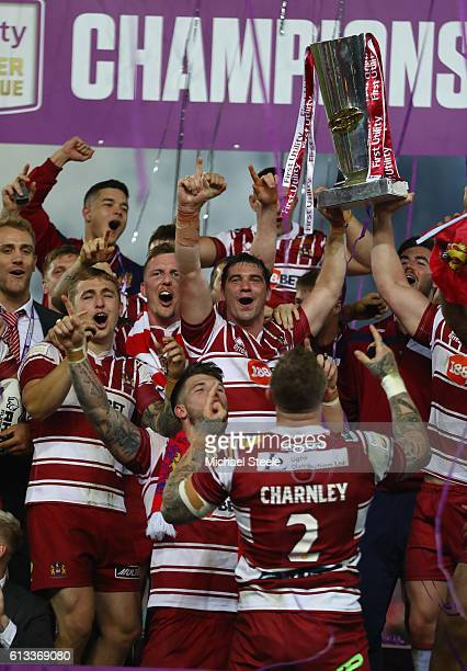 Matty Smith of Wigan lifts the winners trophy after their sides 126 victory during the First Utility Super League Final between Warrington Wolves and...