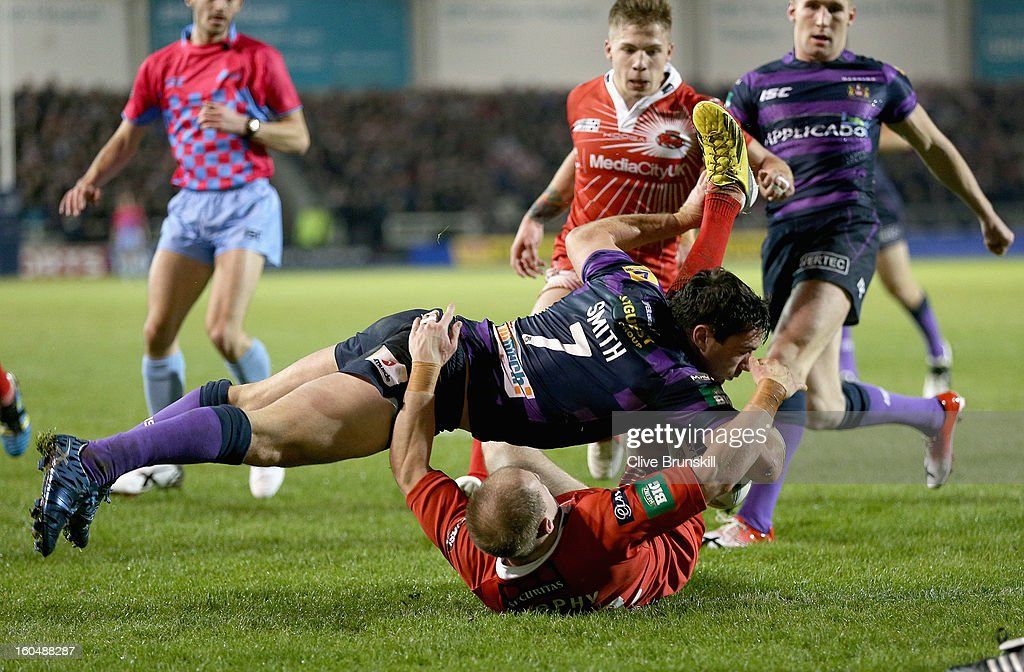 Matty Smith of Wigan scores the second try during the Super League match between Salford City Reds and Wigan Warriors at Salford City Stadium on February 1, 2013 in Salford, England.
