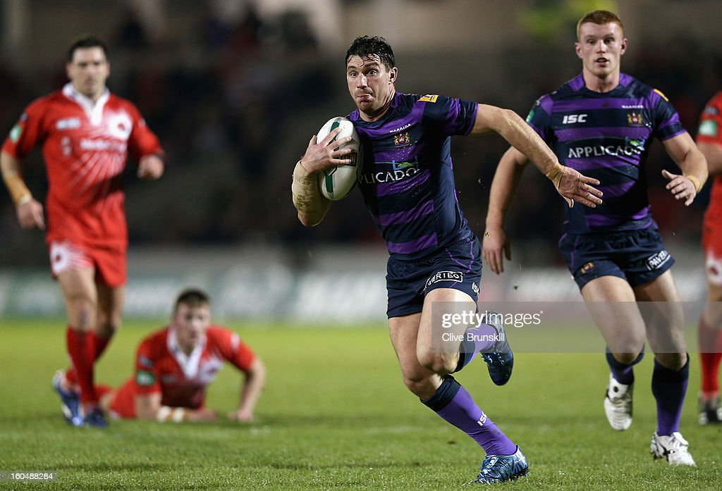 Matty Smith of Wigan Warriors sprints through to score the second try during the Super League match between Salford City Reds and Wigan Warriors at Salford City Stadium on February 1, 2013 in Salford, England.
