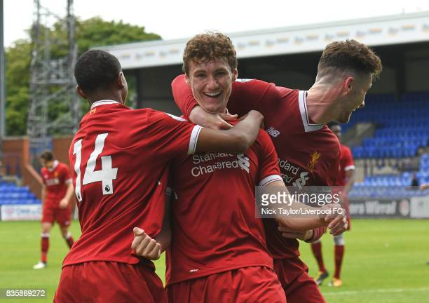 Matty Virtue of Liverpool celebrates his first goal with team mates Rhian Brewster and Corey Whelan during the Liverpool v Sunderland U23 Premier...