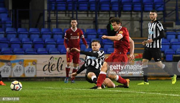 Matty Virtue of Liverpool scores during the Premier League International Cup match between Liverpool U23 and Newcastle United U23 at Prenton Park on...