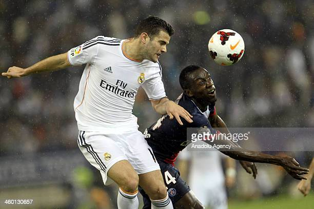 Matuidi Blaise of Paris SaintGermain competes for the ball with Nacho Fernandez of Real Madrid during the International friendly match between Paris...