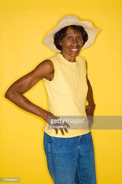 Mature adult African American female standing with hands on hips.