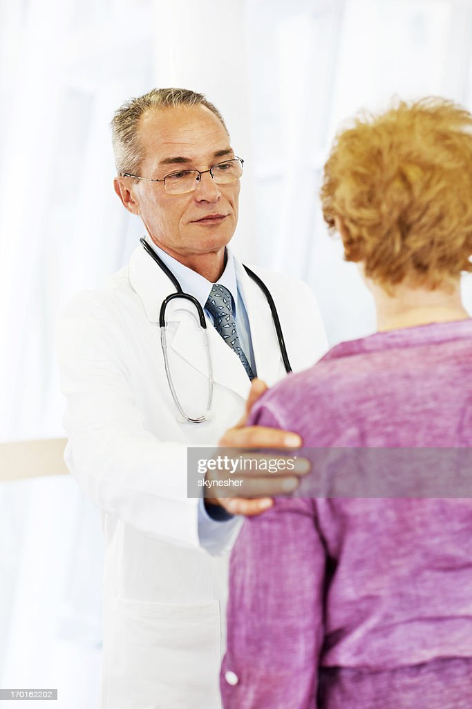 Mature adult male and his patient. : Stock Photo