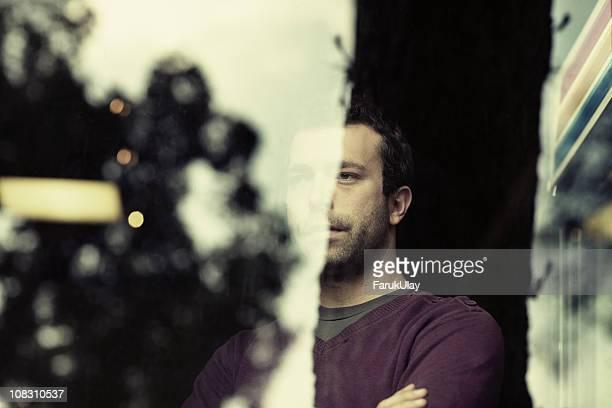 Mature Adult Man behind Glass