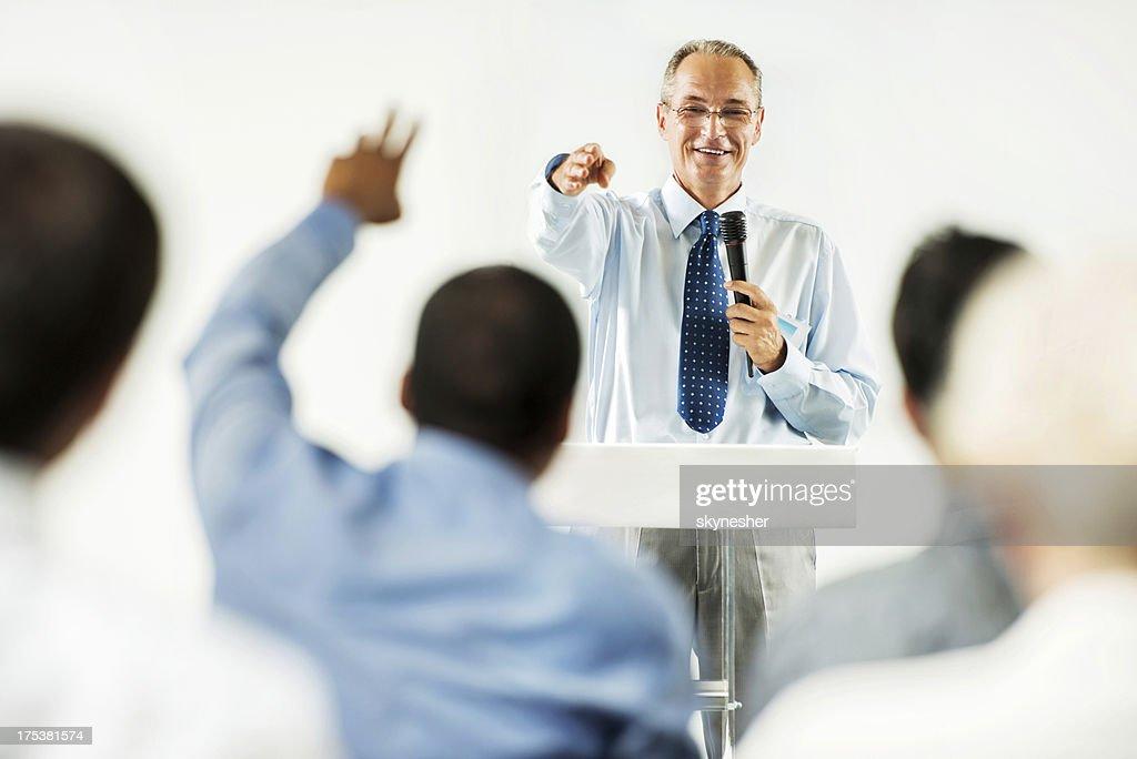 Mature adult man having a public speech. : Stock Photo