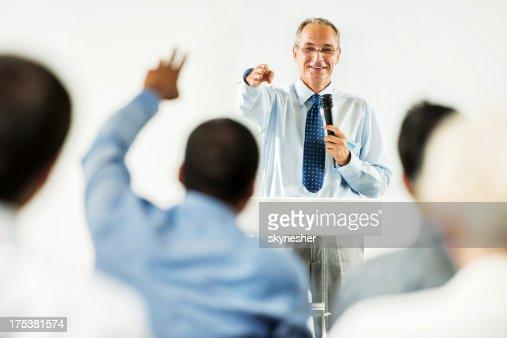 Mature adult man having a public speech.