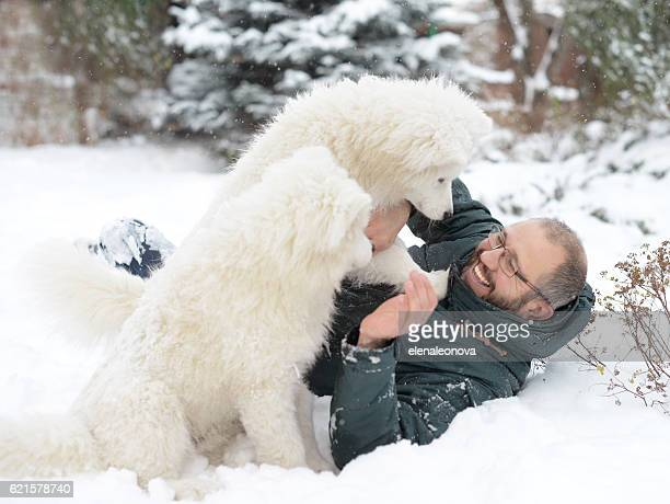 Mature Adult man with a white dog on the nature