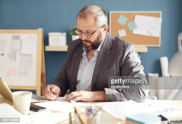 Mature Adult man working in the office
