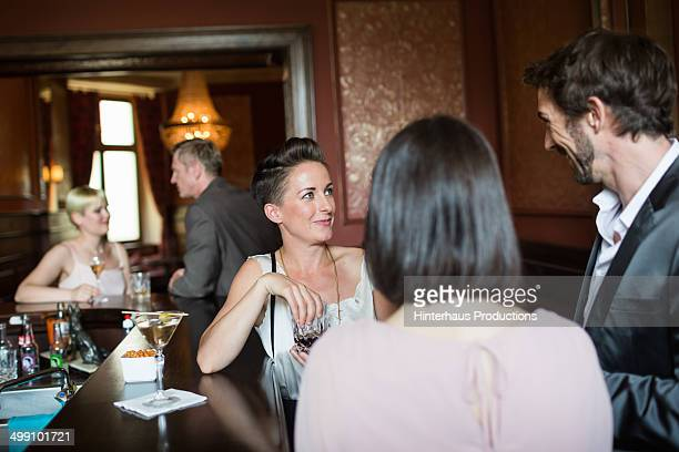 Mature Adults Chatting In A Bar