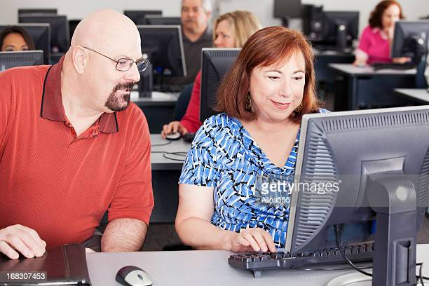 Mature adults working in a computer lab