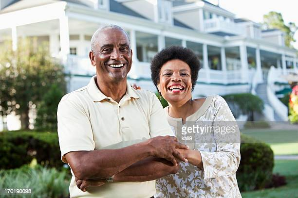 Mature African American couple at country club