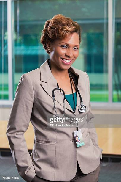 Mature African American female doctor standing in office