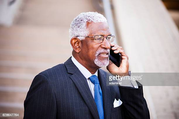 Mature African American Man on Phone