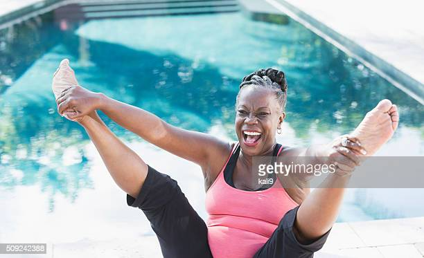 Mature African American woman having fun exercising