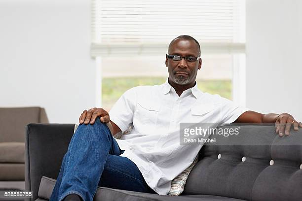 Mature african man wearing smart glasses at home