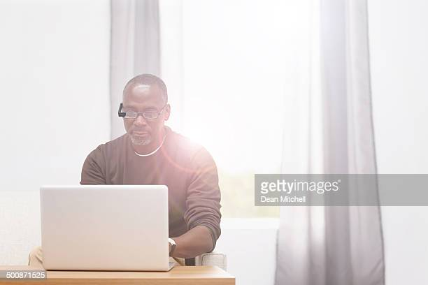 Mature afro american man working from home