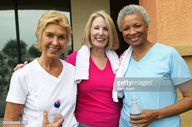 Mature and two senior women in fitness clothes, smiling, portrait