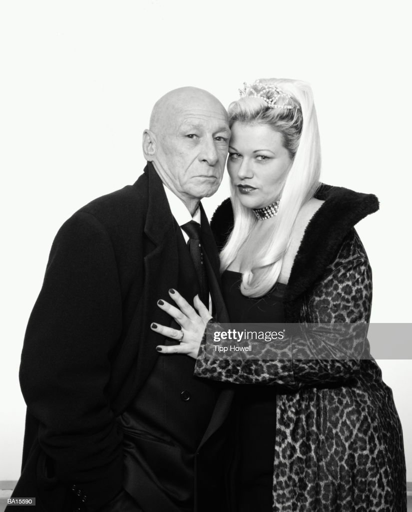 Mature and woman embracing, portrait (B&W) : Stock Photo