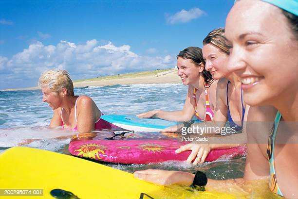 Mature and young women bodyboarding