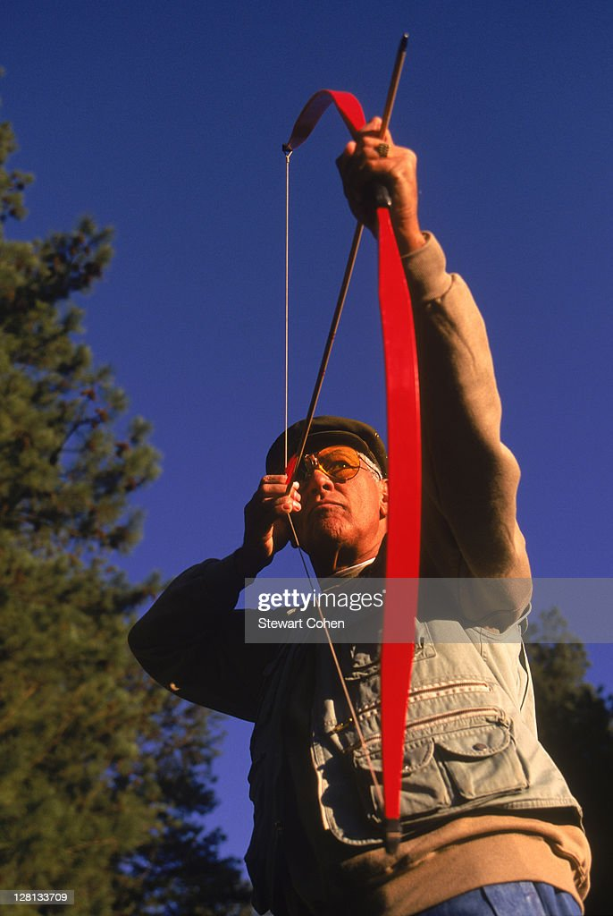 Mature archer takes aim : Stock Photo
