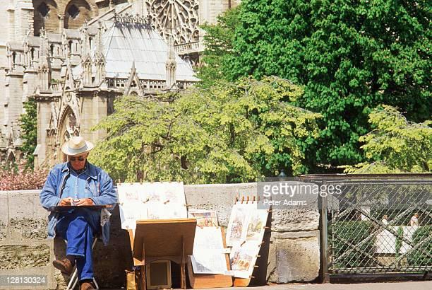 Mature artist, Notre Dame, Paris, France