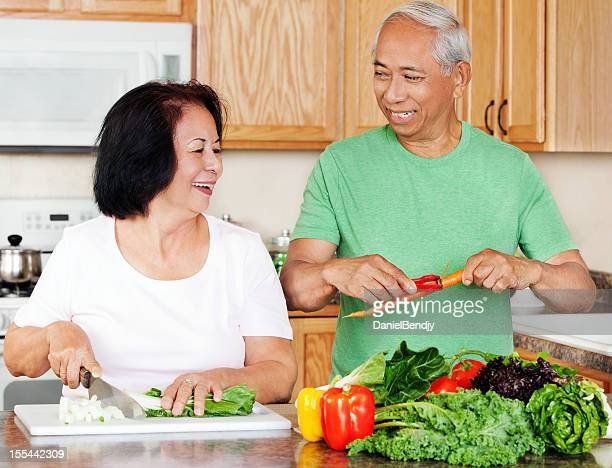 Mature Asian Couple Preparing Meals in the Kitchen