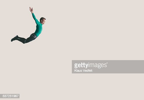 Mature athlete hanging in the air