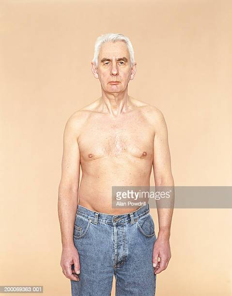 Mature bare chested man wearing jeans, portrait